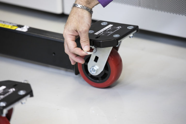 The large front and back caster wheels roll easily over any obstruction and won't mark up data center flooring. The front casters can be locked for easy transport down straight hallways and aisles.