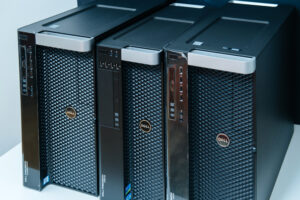 Row of three new Dell Precision T3610 T 7910 Xeon workstation for heavy computing AI calculations - low angle