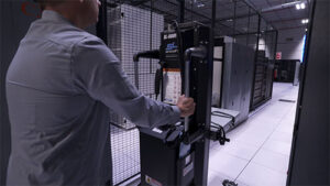 Technician transporting a server with a ServerLIFT device.